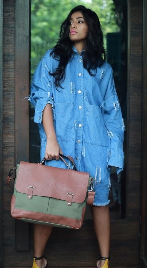 Looking for this brown and olive green messenger bag that Santoshi Shetty is holding. - SeenIt