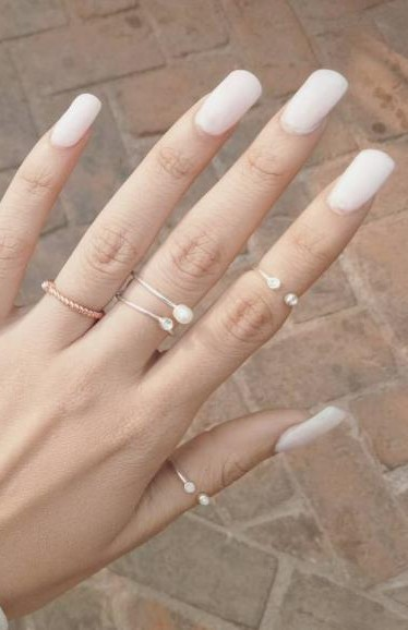 I'm looking for a similar white nailpolish as seen on komalthecollegecouture - SeenIt
