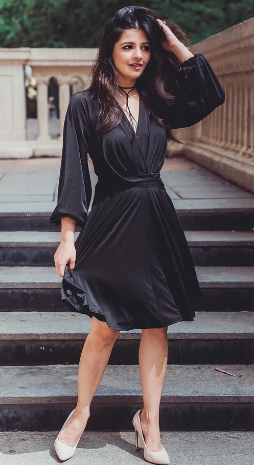 eb84f4eb1cc9 Looking for this black flared dress with bell sleeves that blogger  natontherocks is wearing - SeenIt