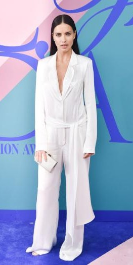 Yay or Nay? Adriana Lima wearing a white plunging neckline jumpsuit at the CFDA Awards 2017 - SeenIt