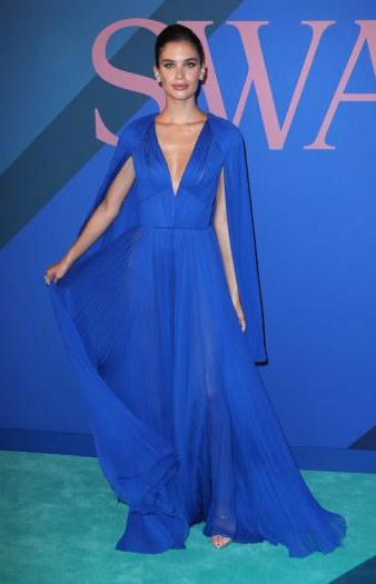 Yay or Nay? Sara Sampaio wearing a blue plunging neckline flared gown at the CFDA Awards 2017 - SeenIt