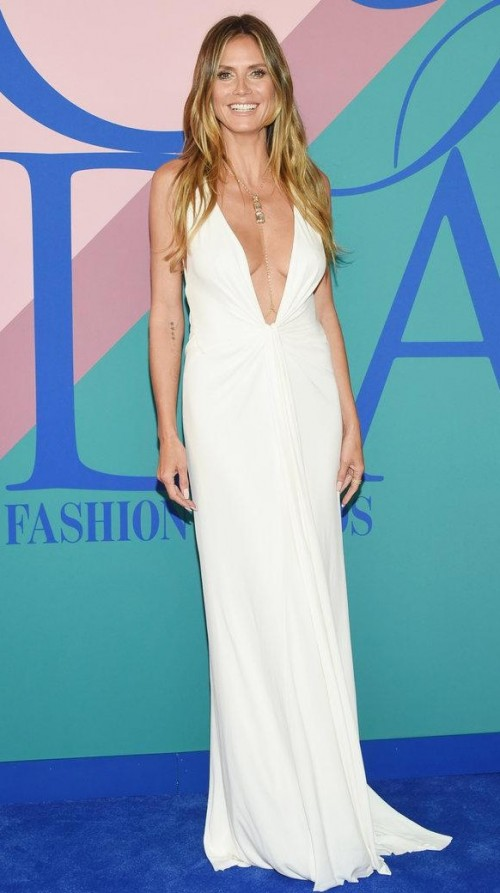 Yay or Nay? Heidi Klum wearing a white plunging neckline gown at the CFDA Awards 2017 - SeenIt