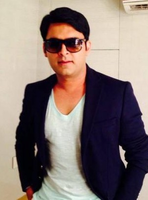4c8fba31118 Looking for a similar navy blazer and white tee with black sunglasses as  seen on Kapil