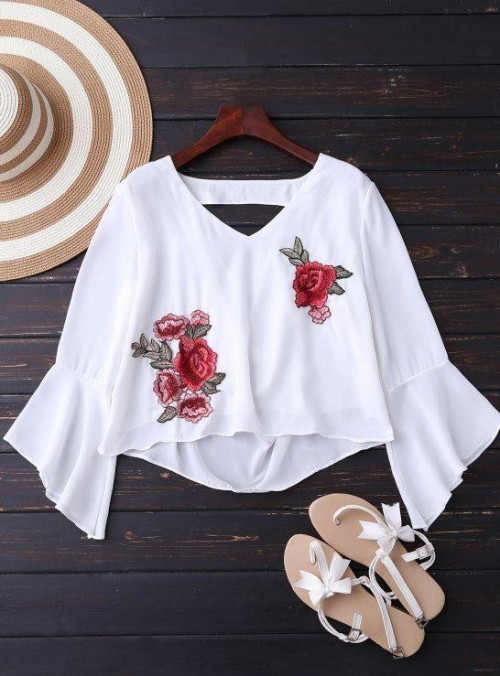 Looking for this white embroidered top with bell sleeves. - SeenIt