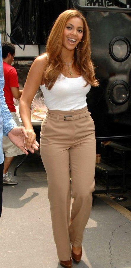 Looking for Beyonce's beige trousers and white tank top - SeenIt
