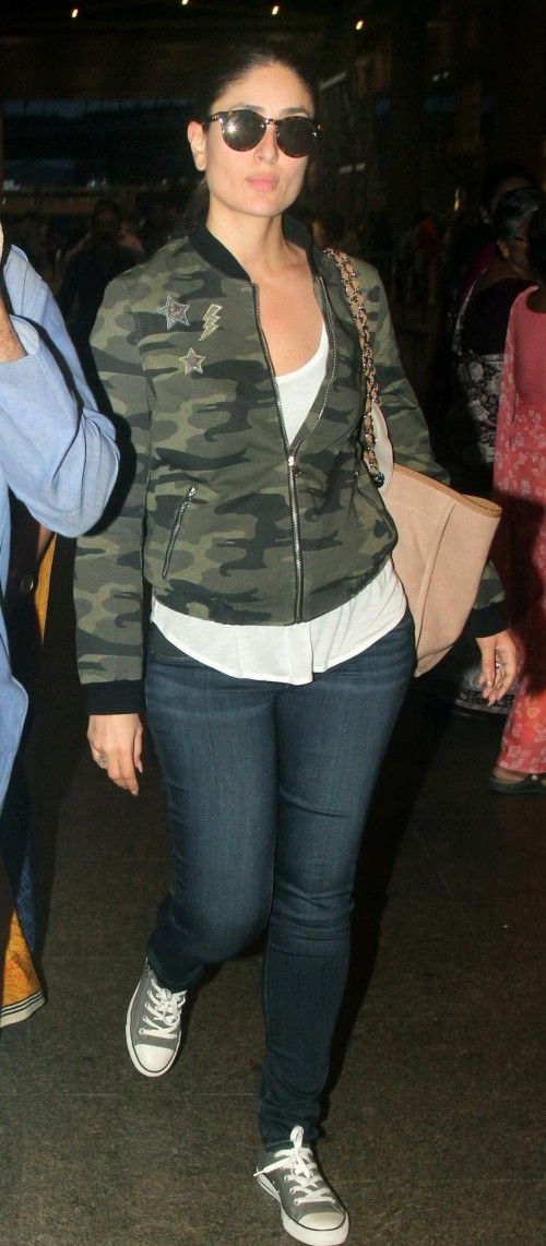 Can you help me find a similar camouflage bomber jacket, white tank top, blue jeans, canvas shoes and sunglasses that Kareena Kapoor is wearing? - SeenIt