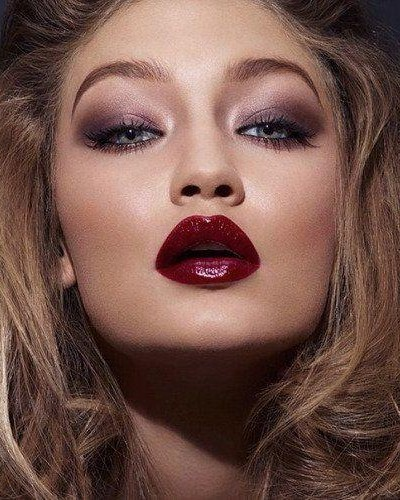 Looking for Gigi Hadid's glossy maroon lipstick and shiny brown eyeshadow - SeenIt