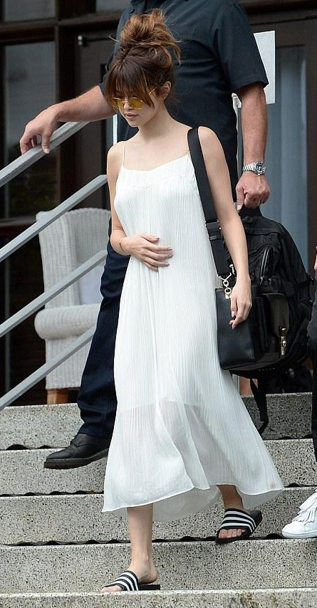 Looking for a similar white midi cami dress and black striped slides as seen on Selena Gomez. - SeenIt