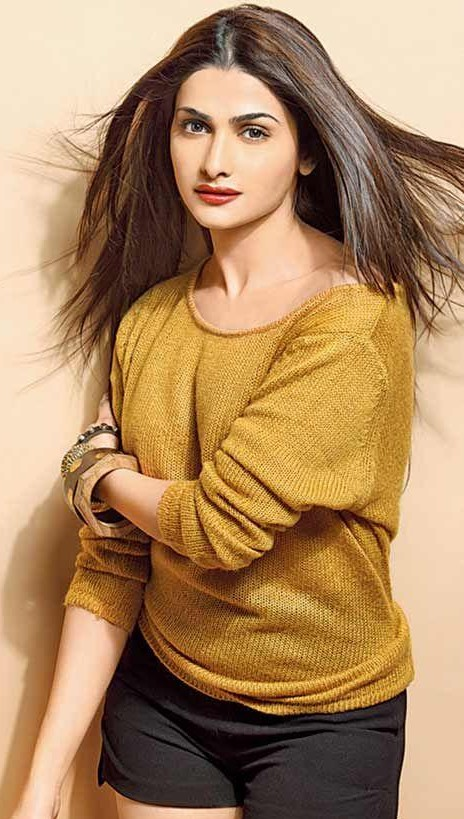 Looking for Prachi Desai's yellow sweatshirt and black shorts - SeenIt