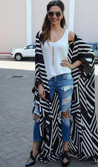 Want the black and white cape which Deepika Padukone is wearing - SeenIt