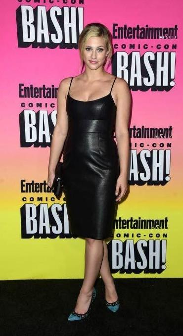 Looking for Lili Reinhart's sleeveless black leather  midi dress - SeenIt