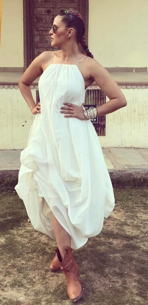 Looking for a similar white asymmetric midi dress and brown boots that Neha Dhupia is wearing. - SeenIt
