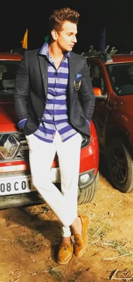 Looking for a similar blue striped shirt, black blazer, white trousers and brown loafers that Prince Narula is wearing. - SeenIt
