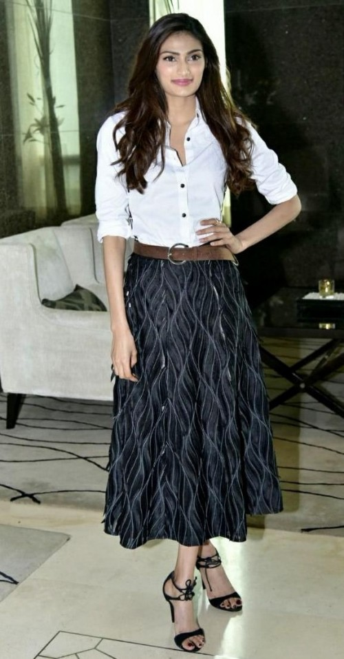 Looking for Athiya Shetty's white shirt, brown belt and black printed midi skirt - SeenIt