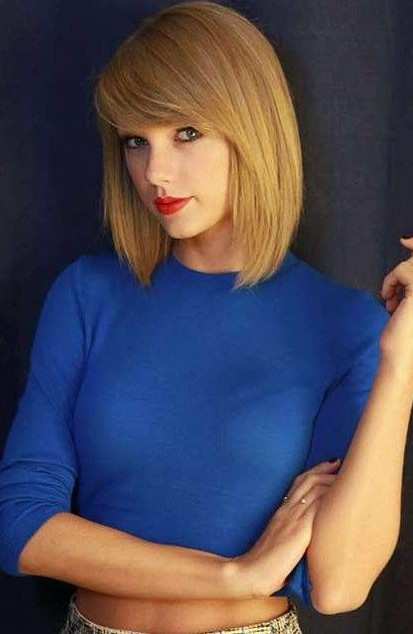 Looking for Taylor Swift's blue high neck crop top and red lipstick - SeenIt