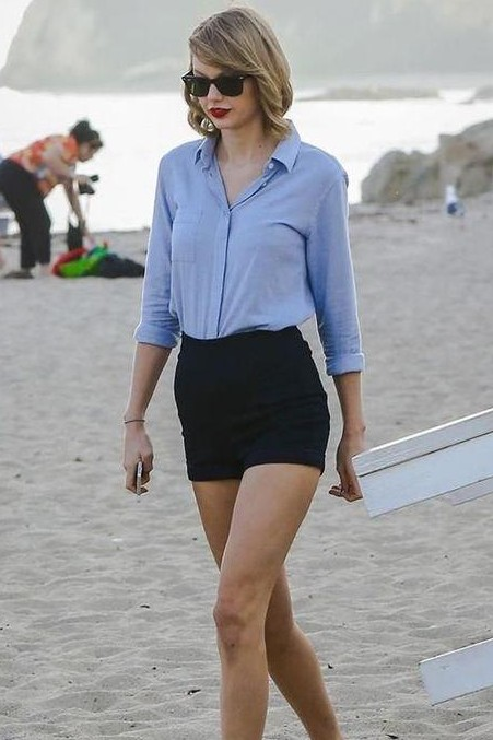 Looking for Taylor Swift's blue shirt and black shorts - SeenIt