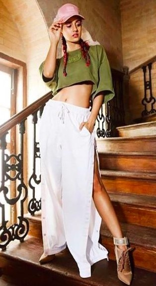 Looking for a similar pink cap, olive green crop top and white slit culottes that Disha Patani is wearing. - SeenIt