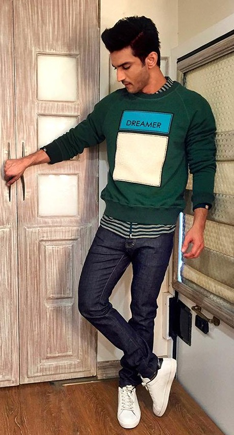 Help me find a similar green sweatshirt, navy blue jeans and white sneakers that Sushant SIngh Rajput is wearing. - SeenIt