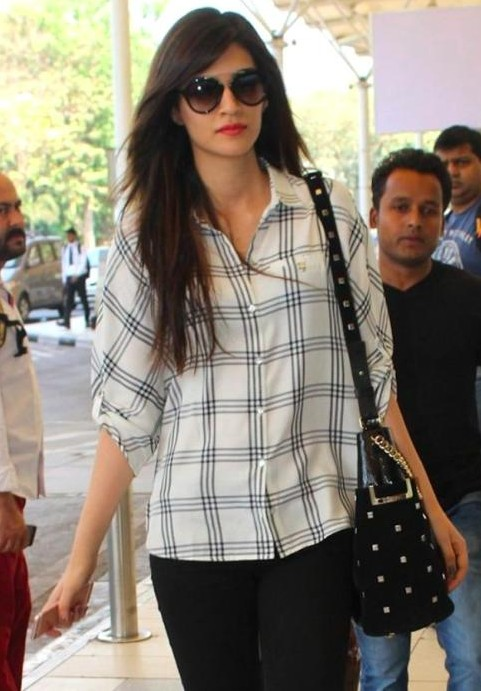 Looking for a similar white checked shirt, sunglasses and black bag that Kriti Sanon is wearing. - SeenIt