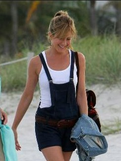 Looking for a similar blue dungaree and broad brown belt and white tank top that Jennifer Aniston is wearing. - SeenIt