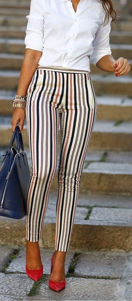 Looking for similar white shirt and a pant with black orange white bold stripes and red heels - SeenIt