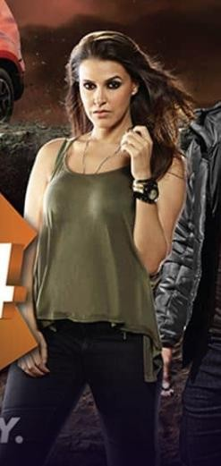 I'm looking for a similar olive green tank top and black jeans that Neha Dhupia is wearing in mtvroadies - SeenIt