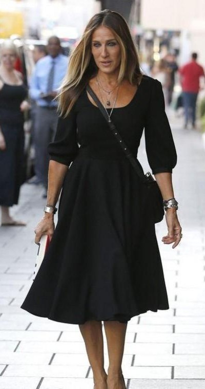 Help me find a black flare midi dress similar to what Sarah Jessica Parker is wearing in this picture - SeenIt