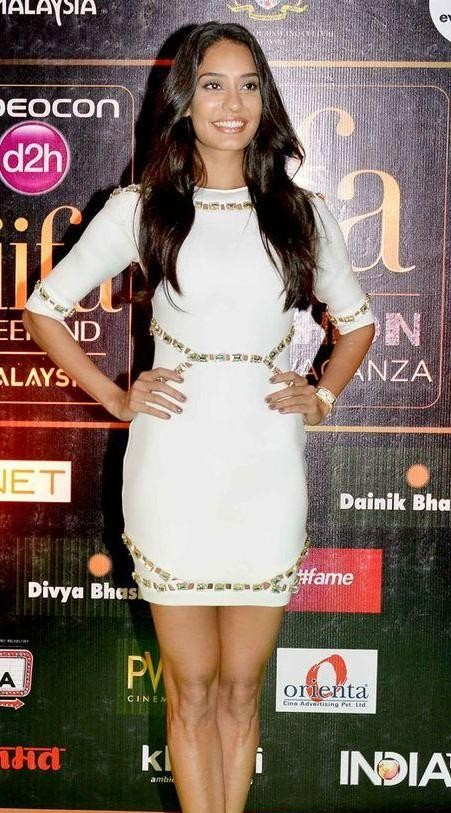 Looking for Lisa Haydon's white bodycon mini dress with gold detailing - SeenIt