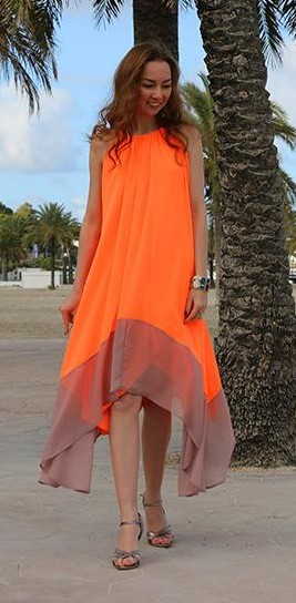 Want this orange and beige colourblock loose halter neck asymmetric midi dress. - SeenIt