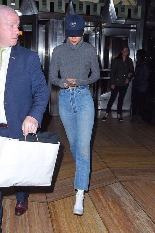 Help me find a similar grey turtle neck top and high waist denim jeans as Kendall Jenner is wearing - SeenIt