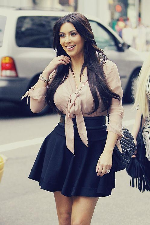 Looking for a similar shirt in any color and black skater skirt as Kim Kardashian is wearing - SeenIt