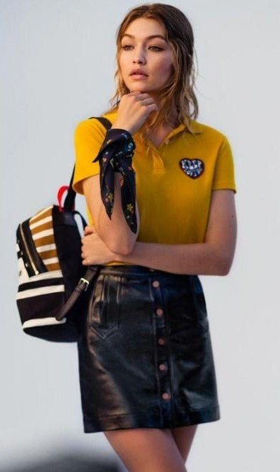 Looking for a similar yellow shirt and leather skirt as Gigi Hadid is wearing - SeenIt
