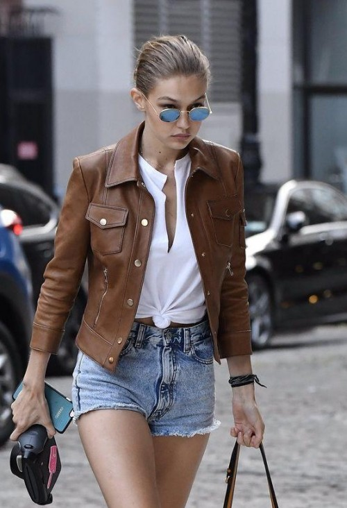 Help me find a similar brown leather jacket and denim shorts as Gigi Hadid is wearing - SeenIt