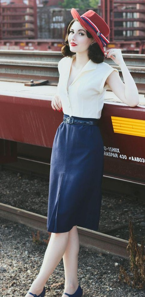 Looking for a similar navy blue knee length skirt, white shirt and red fedora hat. - SeenIt