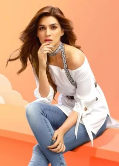 Looking for a similar white off shoulder top and the blue jeans that Kriti Sanon is wearing. - SeenIt
