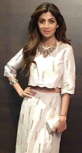 Looking for similar grey crop top with a skirt and the silver necklace as seen on Shilpa Shetty - SeenIt