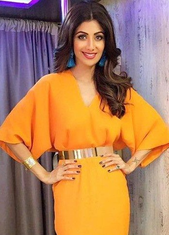 Looking for a similar broad gold belt and gold hand cuff along with blue tassel earring as seen on Shilpa Shetty - SeenIt