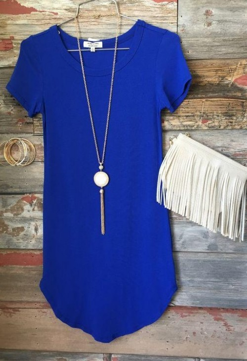 Need this blue tshirt dress alongwith the white fringed clutch, goldtone pendant necklace and bangles. - SeenIt