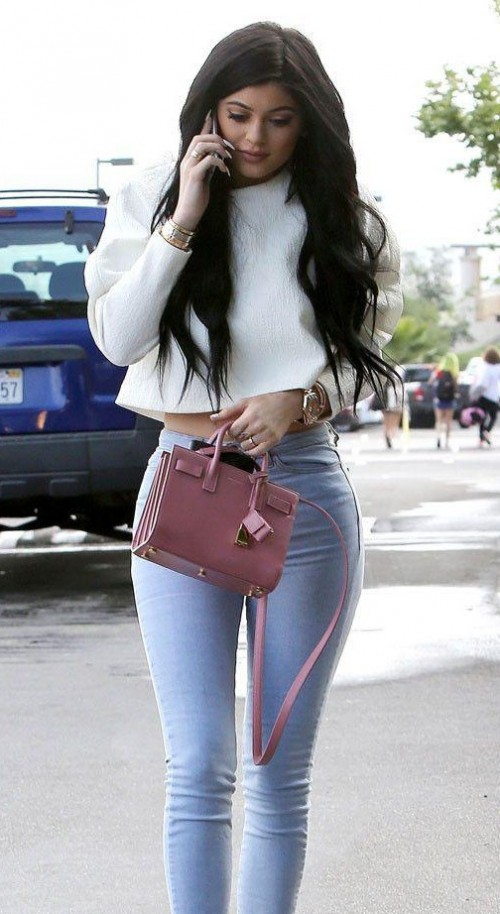 Help me find a similar white crop top with blue jeans as seen on Kylie Jenner - SeenIt