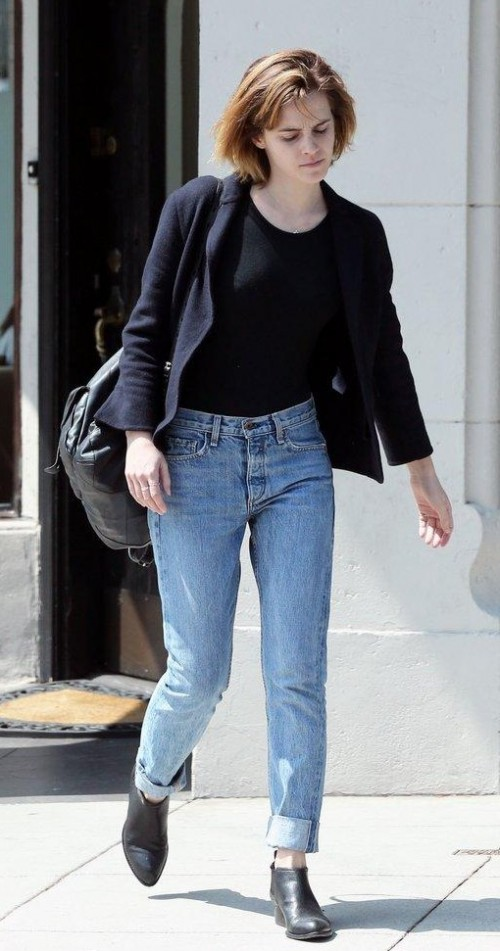 Looking for a similar outfit as seen on Emma Watson complete with a black tee, jacket, shoes and blue jeans - SeenIt
