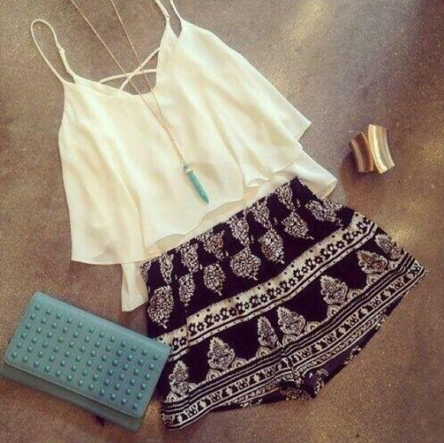 Looking for a similar white cami top, printed shorts and a blue clutch - SeenIt