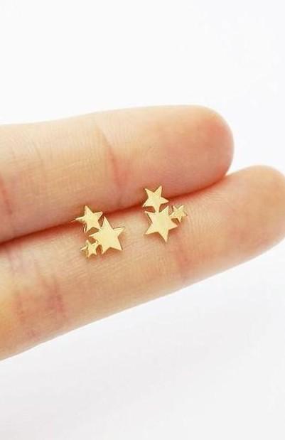 Looking for a similar golden star earrings - SeenIt