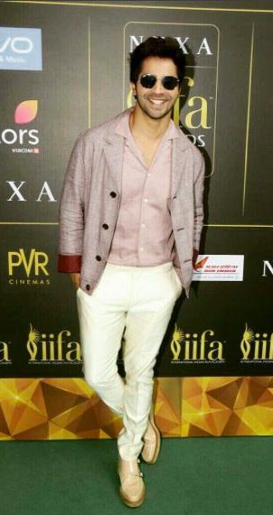 Looking for a similar pink blazer, pink shirt and white pants that Varun Dhawan is wearing. - SeenIt