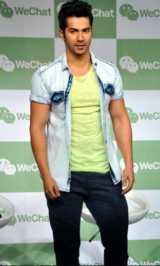 Looking for a similar light coloured denim jacket and a yellow t-shirt with the black jeans that Varun Dhawan is wearing. - SeenIt