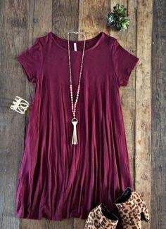 Looking for a similar wine tunic dress and tassel necklace and the gold cuff - SeenIt