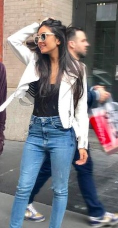 Looking for a similar white blazer, black top and blue jeans that Alaviaa Jaaferi is wearing. - SeenIt