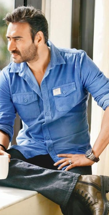 Looking for a similar denim shirt with dark denim jeans and brown shoes that Ajay Devgan is wearing. - SeenIt