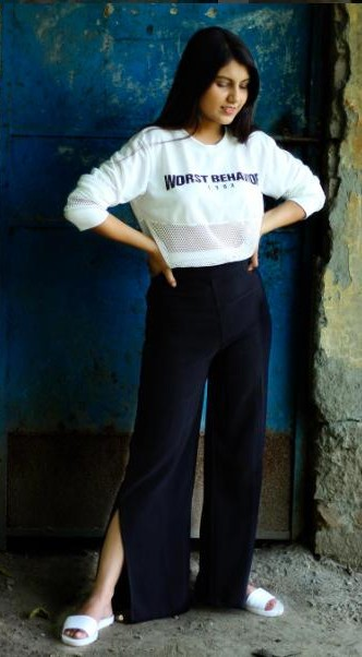 Looking for a similar full sleeves top with 'Worst Behaviour' printed on it and black slit palazzo that Cherry Jain is wearing. - SeenIt