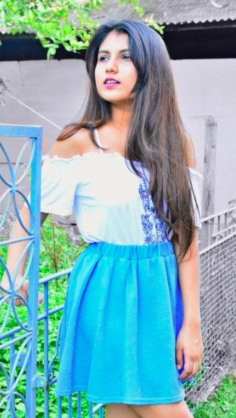 Looking for a similar white off shoulder top an blue skater skirt that Cherry Jain is wearing. - SeenIt