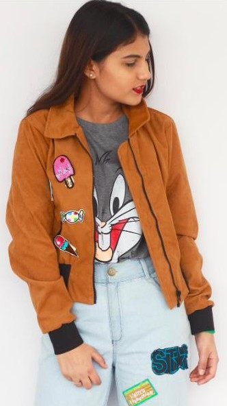 Looking for a similar patched jeans, brown patched jacket and grey Bugs Bunny t-shirt that Cherry Jain is wearing. - SeenIt